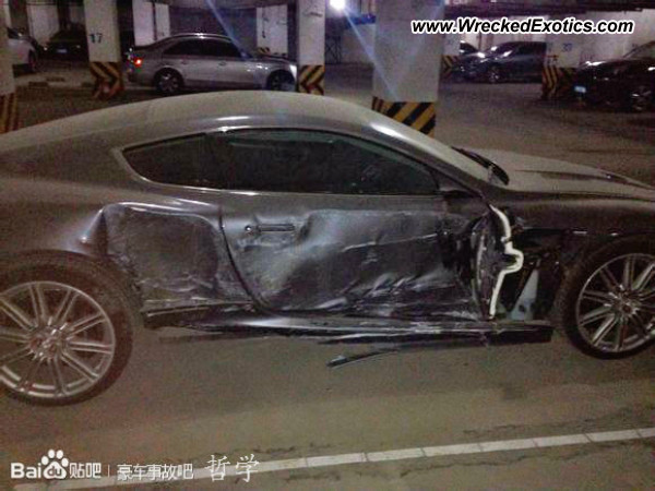 Aston Martin DBS wrecked in garage