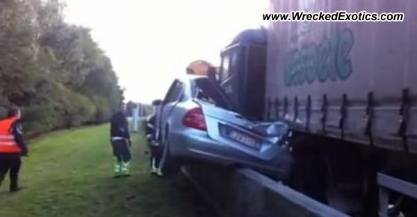 E-Class crushed under truck on highway